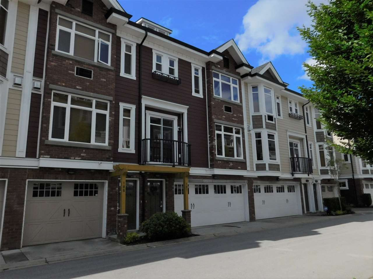 "Main Photo: 107 20738 84 Avenue in Langley: Willoughby Heights Townhouse for sale in ""Yorkson Creek"" : MLS®# R2541424"
