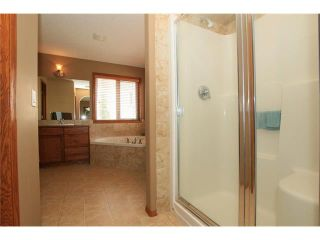 Photo 23: 18 WEST POINTE Manor: Cochrane House for sale : MLS®# C4072318