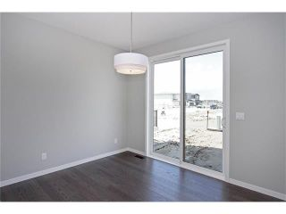 Photo 10: 158 WALGROVE Drive SE in Calgary: Walden House for sale : MLS®# C4075055