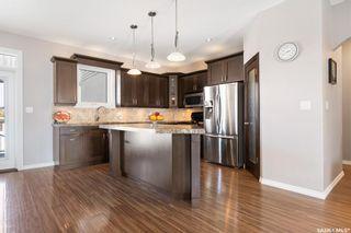 Photo 4: 4419 Sandpiper Crescent East in Regina: The Creeks Residential for sale : MLS®# SK868479