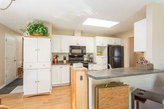 """Photo 5: 37 11502 BURNETT Street in Maple Ridge: East Central Townhouse for sale in """"TELOSKY VILLAGE"""" : MLS®# R2201064"""