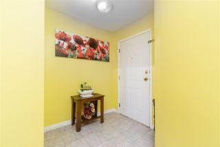"Photo 4: 105 33738 KING Road in Abbotsford: Poplar Condo for sale in ""College Park"" : MLS®# R2494775"