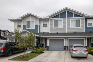 Photo 1: 205 Jumping Pound Common: Cochrane Row/Townhouse for sale : MLS®# A1138561