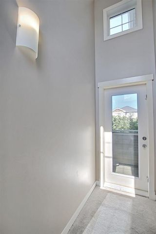 Photo 27: 504 281 Cougar Ridge Drive SW in Calgary: Cougar Ridge Row/Townhouse for sale : MLS®# A1123514