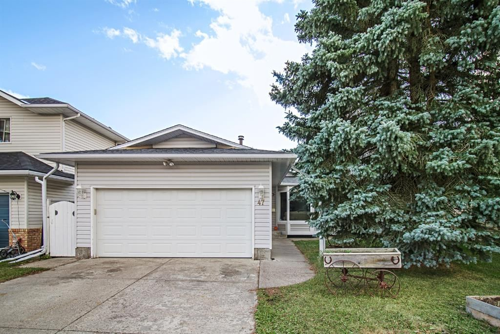 Main Photo: 47 Woodstock Road SW in Calgary: Woodlands Detached for sale : MLS®# A1142826