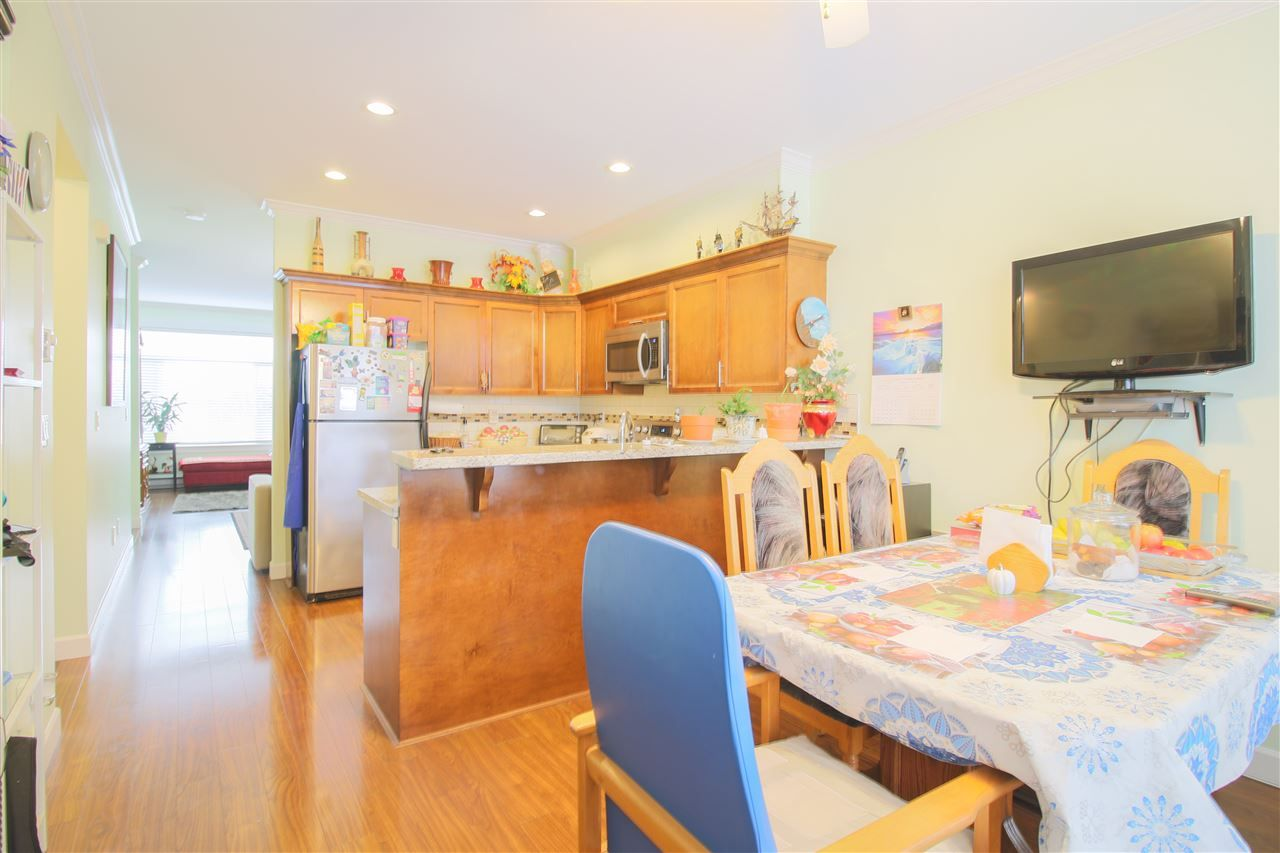 """Main Photo: 12 13393 BARKER Street in Surrey: Queen Mary Park Surrey Townhouse for sale in """"GRAND LANE"""" : MLS®# R2429151"""