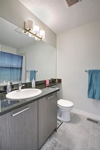 Photo 19: 2103 Jumping Pound Common: Cochrane Row/Townhouse for sale : MLS®# A1119563