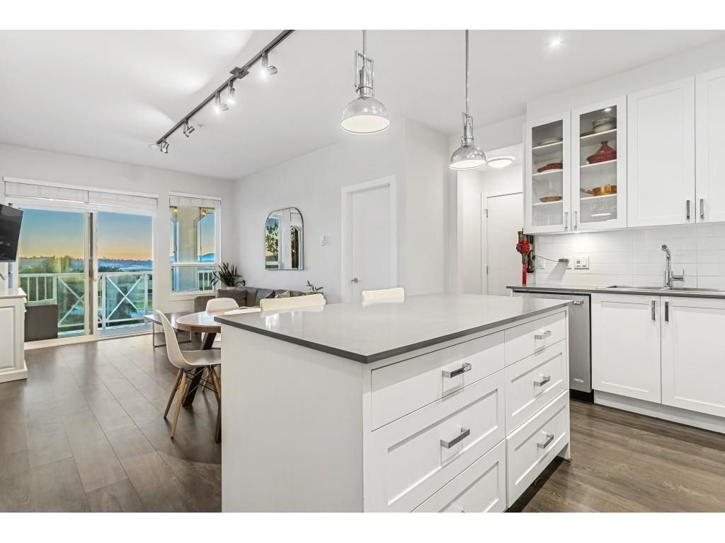 "Main Photo: 411 16380 64 Avenue in Surrey: Cloverdale BC Condo for sale in ""BOSE FARM"" (Cloverdale)  : MLS®# R2606531"