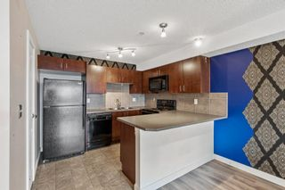Photo 2: 311 108 Country  Village Circle NE in Calgary: Country Hills Village Apartment for sale : MLS®# A1099038
