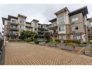 Photo 1: 401 11935 BURNETT Street in Maple Ridge: East Central Condo for sale : MLS®# R2625610