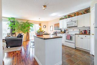 Photo 3: 21 Bow Ridge Crescent: Cochrane Detached for sale : MLS®# A1079980