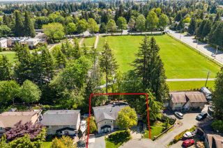 Photo 1: 4860 206 Street in Langley: Langley City House for sale : MLS®# R2585105