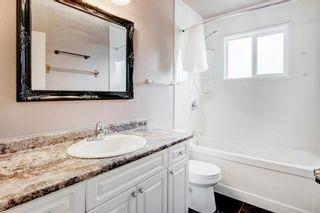 Photo 13: 411 Goddard Avenue NE in Calgary: Greenview Row/Townhouse for sale : MLS®# A1119433