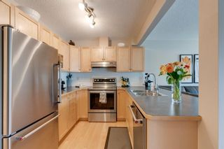 Photo 6: 11 Country Village Circle NE in Calgary: Country Hills Village Row/Townhouse for sale : MLS®# A1118288