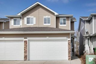 Main Photo: 79 Rockmont Court NW in Calgary: Rocky Ridge Semi Detached for sale : MLS®# A1088526