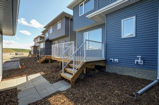 Photo 30: 112 Creekside Drive SW in Calgary: C-168 Semi Detached for sale : MLS®# A1060918