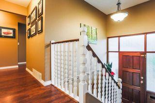 "Photo 11: 7387 142 Street in Surrey: East Newton House for sale in ""Nichol Creek Estates"" : MLS®# R2228884"