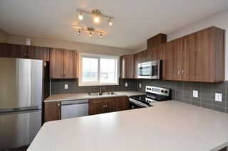 Photo 11: 52 SUNSET Road: Cochrane House for sale : MLS®# C4124887