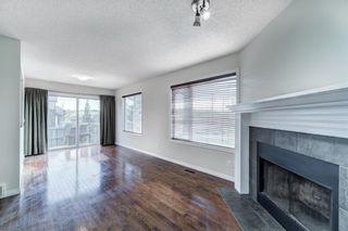 Photo 9: 4 136 Bow Ridge Drive: Cochrane Row/Townhouse for sale : MLS®# A1116097