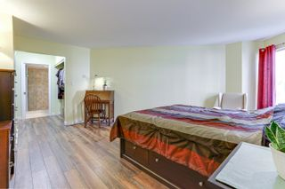 """Photo 12: 205 33401 MAYFAIR Avenue in Abbotsford: Central Abbotsford Condo for sale in """"MAYFAIR GARDENS"""" : MLS®# R2611471"""