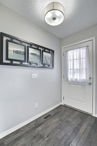 Photo 4: 731 101 Sunset Drive: Cochrane Row/Townhouse for sale : MLS®# A1077505