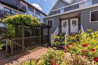 Photo 1: 161 E 4TH Street in North Vancouver: Lower Lonsdale Townhouse for sale : MLS®# R2587641