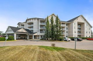 Photo 2: 301 305 1 Avenue NW: Airdrie Apartment for sale : MLS®# A1134588