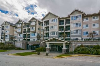"Photo 1: 304 19673 MEADOW GARDENS Way in Pitt Meadows: North Meadows PI Condo for sale in ""THE FAIRWAYS"" : MLS®# R2148787"