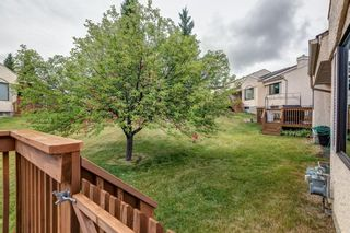 Photo 24: 71 Sandarac Circle NW in Calgary: Sandstone Valley Row/Townhouse for sale : MLS®# A1141051