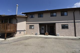 Photo 2: 7 1706 22 Avenue: Didsbury Row/Townhouse for sale : MLS®# A1112062