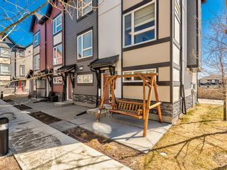 Photo 2: 402 11 Evanscrest Mews NW in Calgary: Evanston Row/Townhouse for sale : MLS®# A1095626