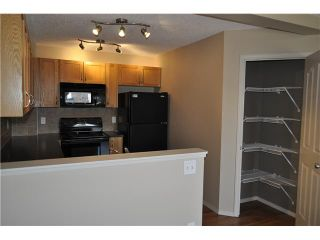 Photo 3: 159 BAYSIDE Point SW: Airdrie Townhouse for sale : MLS®# C3566247