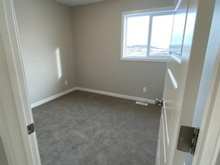 Photo 21: 1043 Lanark Boulevard: Airdrie Row/Townhouse for sale : MLS®# A1059555