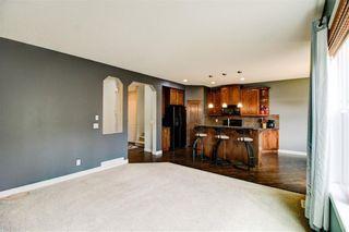 Photo 7: 417 Cimarron Boulevard: Okotoks Detached for sale : MLS®# C4301022