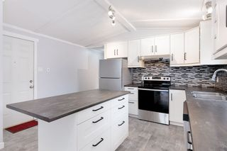 """Photo 6: 142 145 KING EDWARD Street in Coquitlam: Maillardville Manufactured Home for sale in """"MILL CREEK VILLAGE"""" : MLS®# R2518910"""