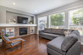 """Photo 2: 7021 195A Street in Surrey: Clayton House for sale in """"Clayton"""" (Cloverdale)  : MLS®# R2594485"""