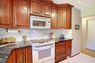 Photo 3: 2716 LOUGHEED Drive SW in Calgary: Lakeview Detached for sale : MLS®# A1032404