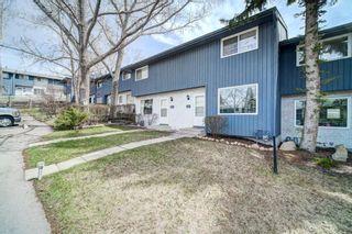 Photo 2: 32 800 Bowcroft Place: Cochrane Row/Townhouse for sale : MLS®# A1106385