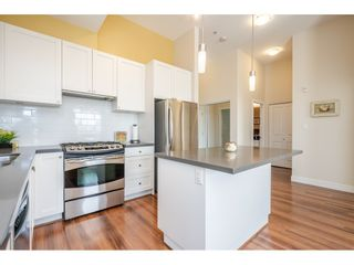 """Photo 4: 407 15850 26 Avenue in Surrey: Grandview Surrey Condo for sale in """"THE SUMMIT HOUSE"""" (South Surrey White Rock)  : MLS®# R2444277"""