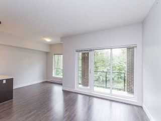 "Photo 2: 501 2362 WHYTE Avenue in Port Coquitlam: Central Pt Coquitlam Condo for sale in ""AQUILA"" : MLS®# R2179817"