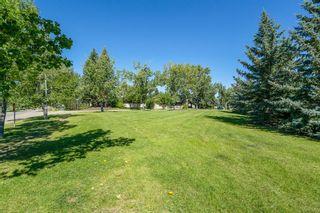 Photo 5: 14048 PARKLAND Boulevard SE in Calgary: Parkland Detached for sale : MLS®# A1018144