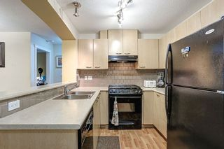 Photo 3: 115 2958 SILVER SPRINGS BOULEVARD - LISTED BY SUTTON CENTRE REALTY in Coquitlam: Westwood Plateau Condo for sale : MLS®# R2094574