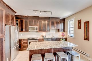 Photo 2: 4 1299 COAST MERIDIAN Road in Coquitlam: Burke Mountain Townhouse for sale : MLS®# R2156577