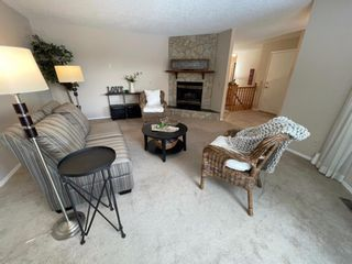 Photo 5: 15 Coach Side Terrace SW in Calgary: Coach Hill Row/Townhouse for sale : MLS®# A1071978