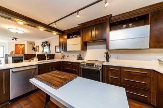 """Main Photo: 206 4323 GALLANT Avenue in North Vancouver: Deep Cove Condo for sale in """"The Coveside"""" : MLS®# R2545362"""