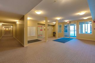 Photo 31: 9302 403 MACKENZIE Way SW: Airdrie Apartment for sale : MLS®# A1032027