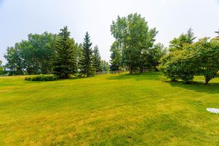 Photo 3: 126 Country Club Lane in Rural Rocky View County: Rural Rocky View MD Semi Detached for sale : MLS®# A1129942
