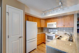 Photo 9: 406 300 Edwards Way NW: Airdrie Apartment for sale : MLS®# A1071313