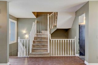Photo 6: 32 COACHWAY Garden SW in Calgary: Coach Hill Row/Townhouse for sale : MLS®# C4293190