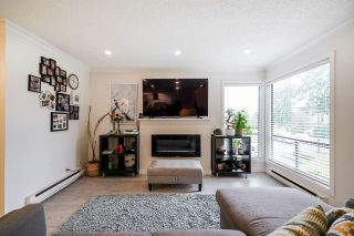 "Photo 10: 10634 HOLLY PARK Lane in Surrey: Guildford Townhouse for sale in ""HOLLY PARK"" (North Surrey)  : MLS®# R2542348"
